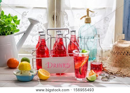 Tasty Red Orangeade In Bottle With Mint Leaf