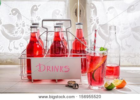 Tasty Red Orangeade In Bottle With Citrus Fruit