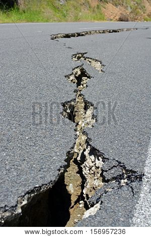 Kaikoura New Zealand - November 15 2016: Closeup of road cracks in the Hunderlee Hills on the road to Kaikoura following the 7.5 Kaikoura Earthquake this week.