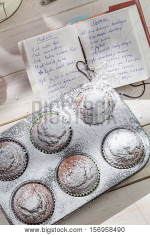 Decorating Sweet Muffins With Caster Sugar On Old White Table