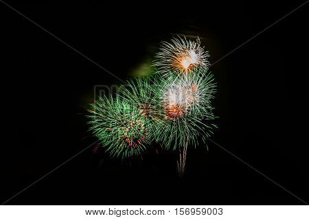 Fireworks in the night.New Year celebration fireworks,Colorful fireworks over dark sky, displayed during a celebration event