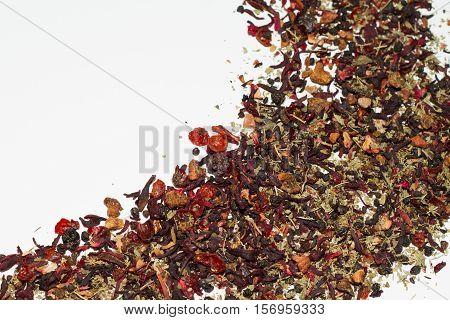 Loose leaf berry tea on white background.