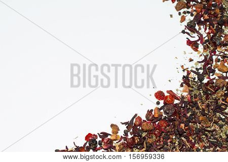 Loose leaf tea with berries on white background