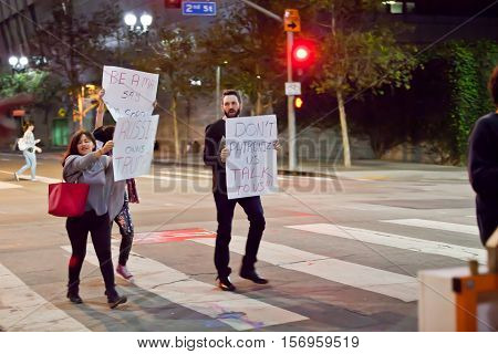 LOS ANGELES, CALIFORNIA - NOVEMBER 11, 2016: Protesters marching down the streets of downtown. Protester holding signs,