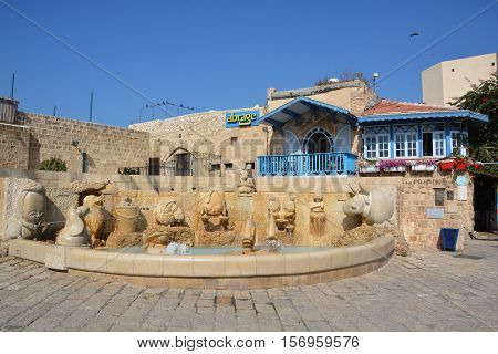 JAFFA ISRAEL 05 11 16: Zodiac Fountain in Kdumim Square, combines effects of water, lighting, and stonework to complete the representation of the 12 chalkstone zodiac sculptures in original designs.