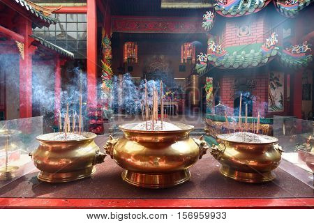 Incense Sticks In The Pot Inside Chinese Temple
