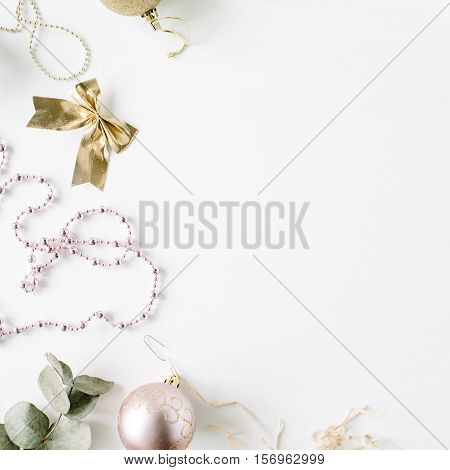 frame made of christmas decoration with christmas glass balls tinsel bow eucalyptus. christmas wallpaper. flat lay top view