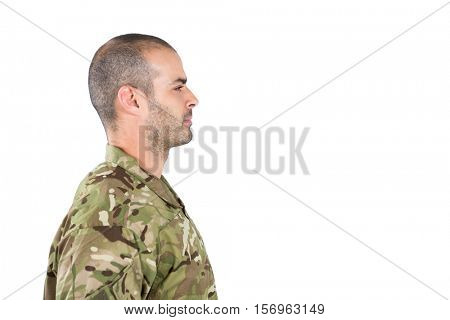 Side view of confident soldier standing against white background