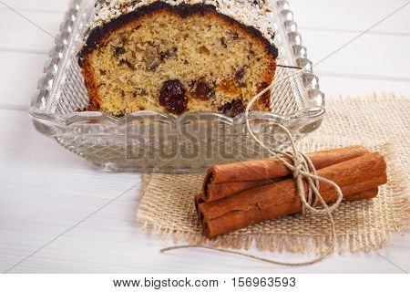 Fresh Baked Fruitcake And Cinnamon On Boards