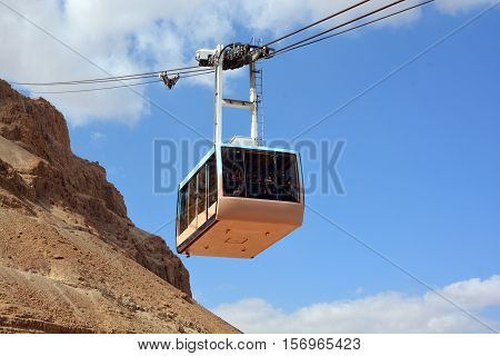 MASADA ISRAEL 04 11 16: Cablecar at the ancient fortress of Masada. Its bottom station is 257 m below and its summit is 33 metres above sea level making it the lowest aerial tramway in the world.