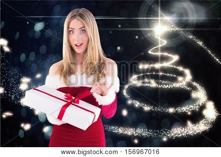Surprised woman in santa costume opening a gift box against digitally generated background