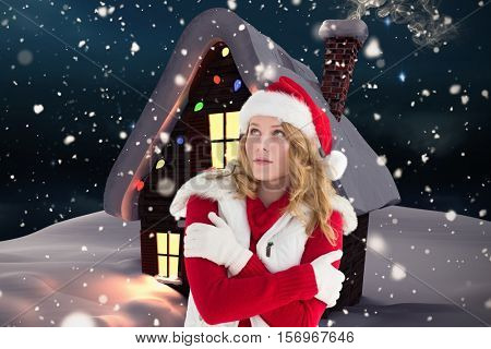 Woman in santa costume shivering with cold during christmas time