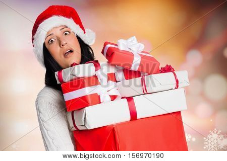Tired woman holding gift boxes during christmas time