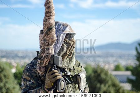 sniper aim target scope multicam ghillie suit,portret blue sky