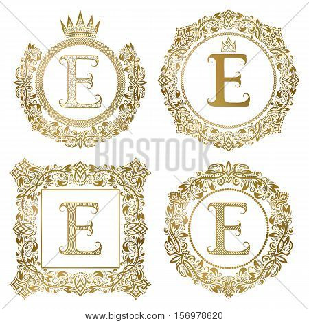 Golden letter E vintage monograms set. Heraldic coats of arms round and square frames.