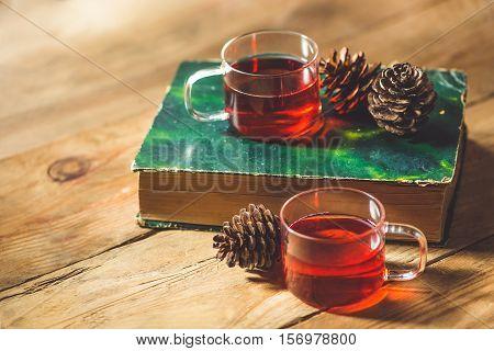 Christmas drink. Glass cup of tea on wood table
