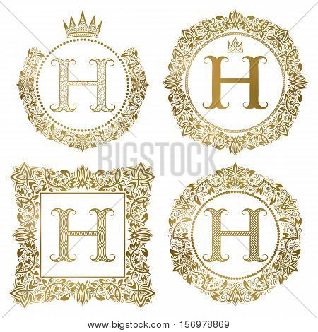 Golden letter H vintage monograms set. Heraldic coats of arms round and square frames.