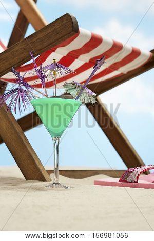 Coctail next deckchair on beach