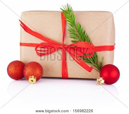 Christmas gift in kraft paper tied a red braid pine tree branch and bauble Isolated on white background