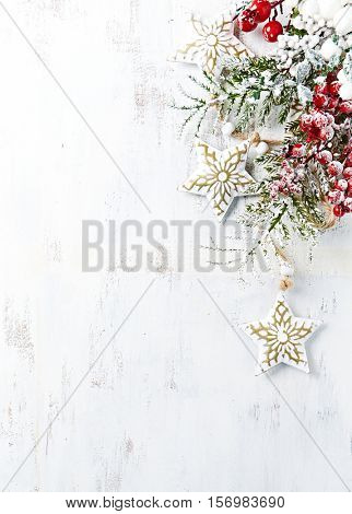 Vintage christmas decoration on white painted wooden background