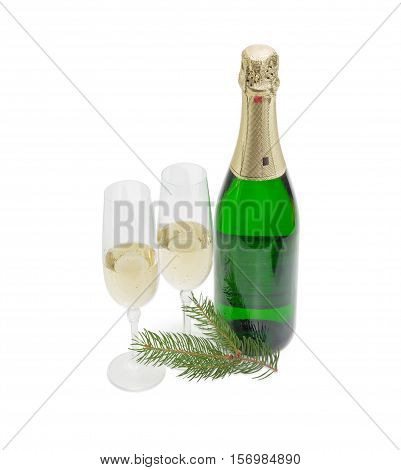 Two wine glasses with sparkling wine and a bottle of wine and fir twig on a light background