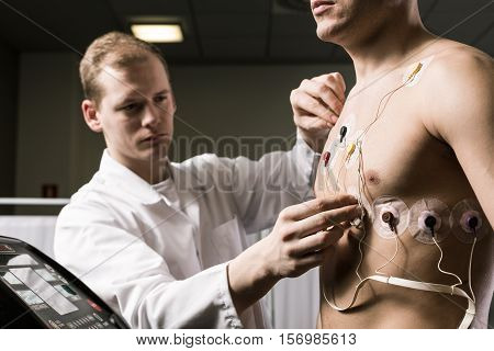 Doctor Putting The Cardiogram Electrodes