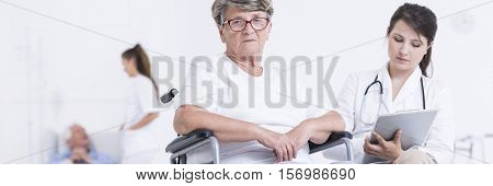 Senior Patient Examinated By Doctor