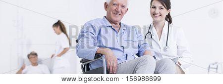 Elderly Smiling Man On Wheelchair