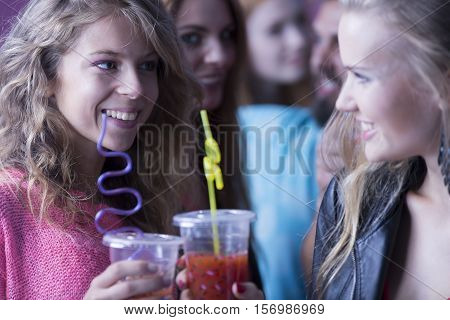 Young women drinking cocktails at a nightclub