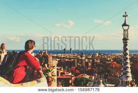young tourist in Park Guell, Barcelona, Spain looking at panoramic view of the city