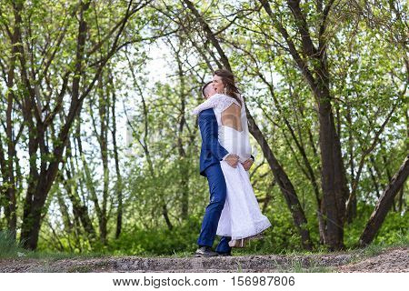 Elegant bride and groom wolking together outdoors on a wedding day