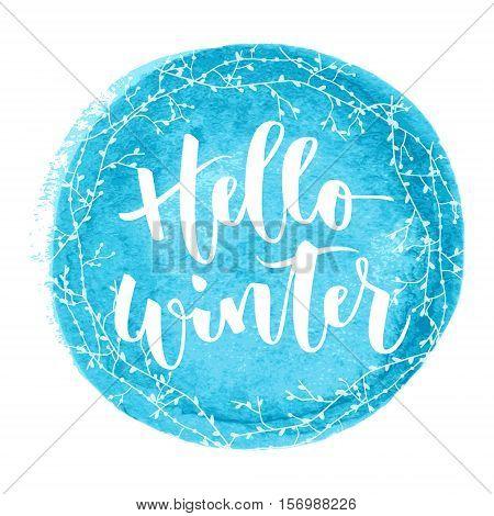 Hello winter white hand written inscription on blue round watercolour background