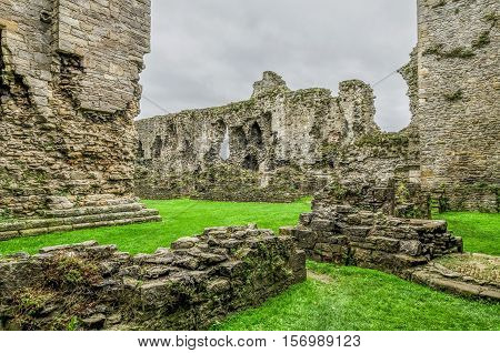 The thick stone walls of Middleham Castle in Wensleydale North Yorkshire built by Robert Fitzrandolf starting in 1190, and childhood palace of Richard the third and now run by the National Trust.