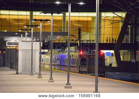 November 16, 2016 in Denver, CO:  Light Rail Train departing the Denver Airport Station for Union Station which is a transportation hub in Denver and this Light Rail Denver Airport Station is where people can ride from the airport to Denver