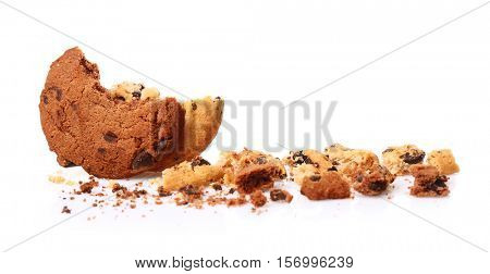 Tasty cookies with chocolate chips and crumbs on white background