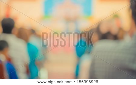 Image Of Blur People Looking To Kid 's Show .