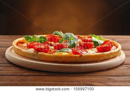 Pizza Margarita on wooden table