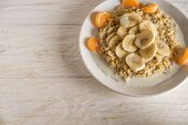 oatmeal with tangerine and banana for breakfast poster