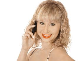 Happy woman speaks on the phone