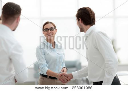 business partners reaching out for a handshake