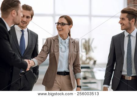 business people reach out to each other.the concept of cooperation