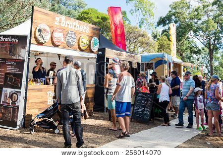 Melbourne, Australia - March 20, 2016: People Buying From Food Trucks At The Warrandyte Festival In