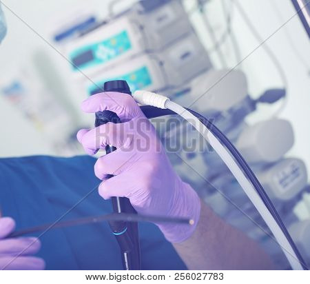 Endoscopic Medical Device In The Hands Of A Surgeon's. Endoscopist Is Ready To Work With The Patient