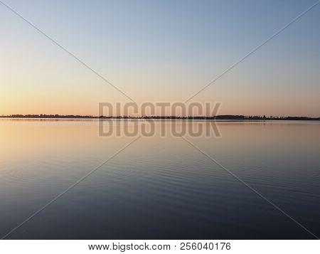 Symmetrical Panorama Of Sun Set Over Artificial European Goczalkowice Reservoir And Coastline Near P
