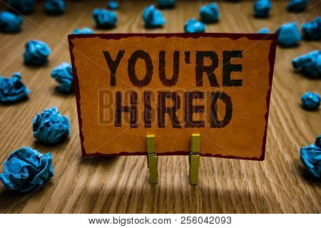Conceptual Hand Writing Showing You Re Are Hired. Business Photo Text New Job Employed Newbie Enlist