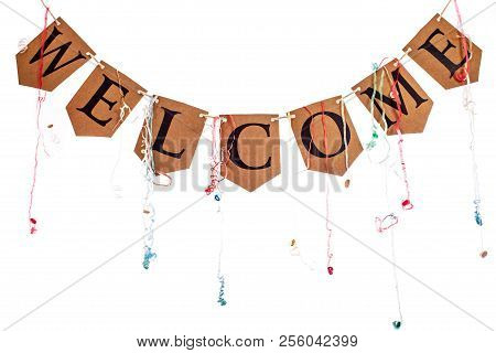 Welcome Home Party Banner Bunting With Streamers Isolated Against White Background. The Word Welcome