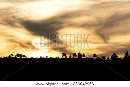 Beautiful Cloudy Sky Over The Field At Sunset