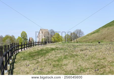 Outdoor View At Old Upsala Protection Area, The Kings Mounds. Fence And Church.