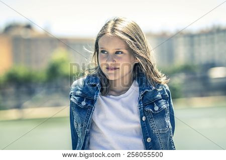 Outdoor Portrait Of Young Girl 10-11 Year Old
