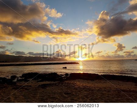 Beautiful Sunset Over The Ocean Along Rocky Shore